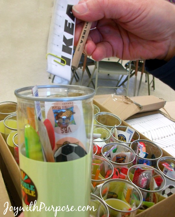 We held a packing party to fill our empty tennis ball containers for our Operation Christmas Child shoebox gifts.